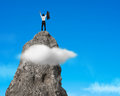 Cheering on top of rocky mountain with blue sky businessman Stock Photography