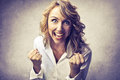 Cheering woman happy smiling putting her fists up Royalty Free Stock Images