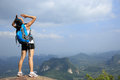 Cheering woman hiker yell at mountain peak Royalty Free Stock Photo