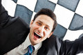 Cheering a young businessman on a checkered background Stock Photo