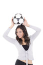 Cheering young woman holding soccer ball on white background this image has attached release Royalty Free Stock Image