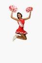 Cheerleader jumping Royalty Free Stock Photo