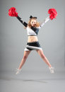 Cheerleader Jumping In Studio Royalty Free Stock Photo