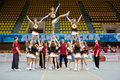 Cheerleaders girl team performs stunt moscow mar at championship and contests of moscow in cheerleading at palace of sports dynamo Stock Image