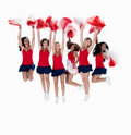 Cheerleaders jumping in the air on white Royalty Free Stock Photo