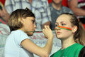 Cheerleaders paint the face during match between bc donetsk donetsk lokomotiv kuban start game of first round of Royalty Free Stock Photos