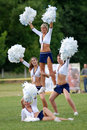 Cheerleaders perform Stock Photo