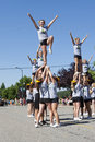 Cheerleaders raised in the air hoist up other teens at rathdrum days rathdrum idaho on july Stock Photo