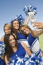 Cheerleaders Taking Self Portrait Stock Image