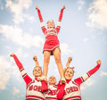 Cheerleaders team with male coach artistic figure their Stock Photos
