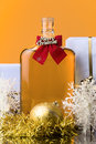 Cheers at christmas time a bottle of whiskey decoration and gift box Stock Photos