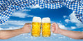 Cheers hands oktoberfest flag Royalty Free Stock Photo
