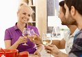 Cheers happy women clinking glasses with friends at dinner Stock Photo