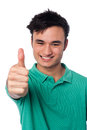 Cheers mate keep up smart young guy showing thumbs Royalty Free Stock Photography