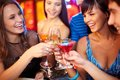 Cheers portrait of joyful friends toasting at birthday party focus on two happy girls Royalty Free Stock Images