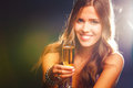 Cheers smiling young woman celebrating with champagne Stock Photo