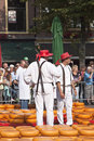 Cheese bearers at cheese market in alkmaar hollan between the gouda cheeses the the netherlands this large year old located Royalty Free Stock Photography