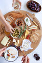 Cheese board with hands, party snacks Royalty Free Stock Photo