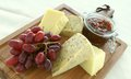 Cheese board selection with cracker biscuits Stock Images