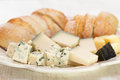 Cheese with bread on white dish Royalty Free Stock Photo