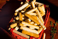 Cheese breadsticks in a red wicker basket Stock Photos