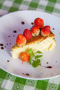 Cheese cake and ice cream on plate with fruit topping tropical Stock Images