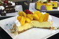 Cheese cake with mango in close up Royalty Free Stock Photos
