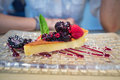 Cheese cake with red fruits and mint leaf in glass tray Royalty Free Stock Photo