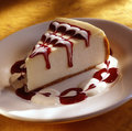 Cheese cake with strawberry sauce Royalty Free Stock Photo