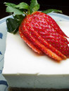Cheese cake with strawberry topped sliced fresh Stock Photos