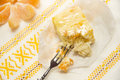 Cheese cake with tangerineson on rustic tablecloth yellow Royalty Free Stock Images