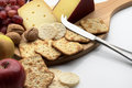 Cheese and crackers board with fruit nuts Royalty Free Stock Image
