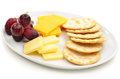 Cheese and crackers with grapes on oval white plate Stock Photography