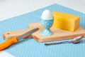 Cheese, egg on cutting board Royalty Free Stock Images