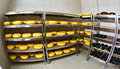 Cheese factory warehouse with shelves of product capretto and la Royalty Free Stock Photo