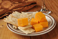 Cheese and flatbread crackers aged cheddar cubes with gourmet Royalty Free Stock Image