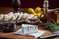 Cheese and fresh ingredients recipe displayed in a rustique style kitchen decor blue serving with pita bread spices olives on Stock Photos