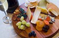 Cheese and fruit platter overhead view of a with sparkling wine Stock Photography