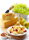 Cheese and fruits Stock Photos