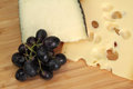 Cheese and grape macro shot Stock Images