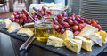 Cheese and grapes laying on a board Stock Images