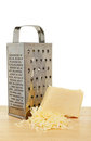 Cheese grater and cheese Royalty Free Stock Images