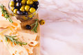 Cheese with green and black olives Royalty Free Stock Photo
