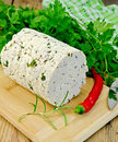 Cheese homemade with spices and pepper on the board herbs knife parsley rosemary red chili napkin a wooden Stock Photo