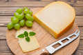 Cheese with knife on board Royalty Free Stock Photo