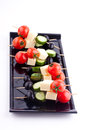 Cheese and olive canapes with tomato and cucumber Stock Photography
