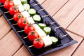 Cheese and olive canapes with tomato and cucumber Stock Images