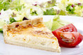 Cheese and onion quiche with tomato Stock Image