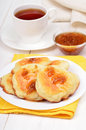 Cheese pancakes confiture and tea cup sweet on white wooden table Stock Images