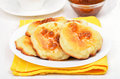 Cheese pancakes with yellow raspberry confiture on white wooden table Stock Image